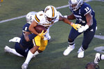 Wyoming State running back Dontae Crow (8) runs for a first down against Nevada during the first half of an NCAA college football game Saturday, Oct. 24, 2020, in Reno, Nev. (AP Photo/Lance Iversen)