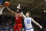 North Carolina State guard Markell Johnson (11) drives to the basket while Duke forward Matthew Hurt (21) defends during the first half of an NCAA college basketball game in Durham, N.C., Monday, March 2, 2020. (AP Photo/Gerry Broome)
