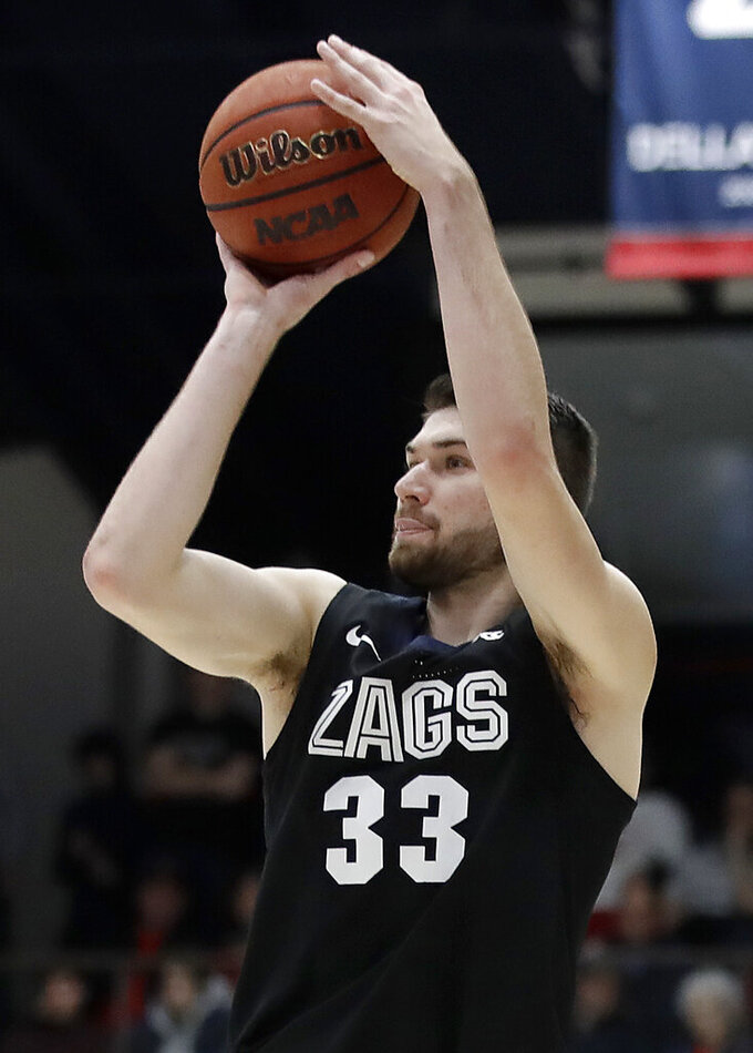 Gonzaga's Killian Tillie shoots against St. Mary's during the second half of an NCAA college basketball game Saturday, Feb. 8, 2020, in Moraga, Calif. (AP Photo/Ben Margot)