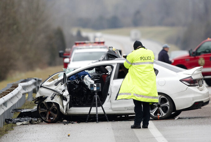 FILE - In this Saturday, Jan. 25, 2020, file photo, emergency crews work the scene of a fatal crash involving a charter bus and car on the AA highway in Campbell County, Ky. U.S. traffic deaths rose 7% last year, the biggest increase in 13 years even though people drove fewer miles due to the coronavirus pandemic, the government's road safety agency reported Thursday, June 3, 2021. (Albert Cesare/The Cincinnati Enquirer via AP)