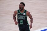 Boston Celtics guard Kemba Walker (8) celebrates after sinking a basket late in the second half of an NBA conference final playoff basketball game against the Miami Heat on Thursday, Sept. 17, 2020, in Lake Buena Vista, Fla. (AP Photo/Mark J. Terrill)