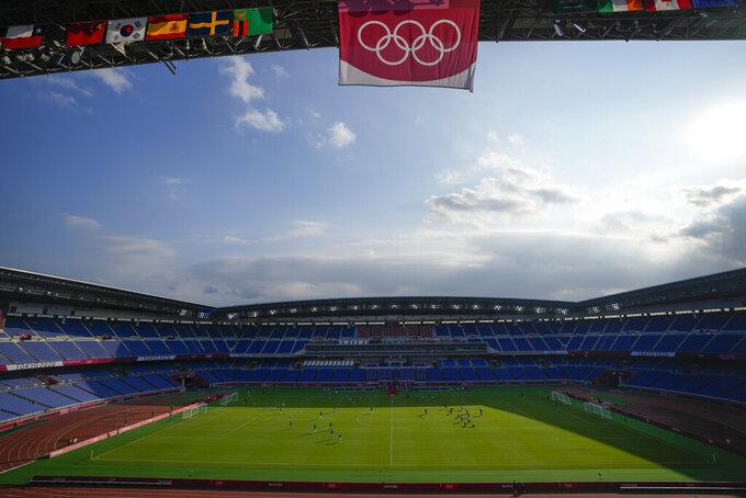 Players of Brazil and Ivory Coast warm up in the International Stadium prior to a men's soccer match at the 2020 Summer Olympics, Sunday, July 25, 2021, in Yokohama, Japan. (AP Photo/Kiichiro Sato)
