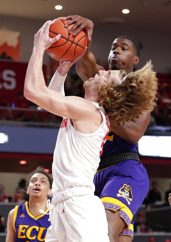 Houston guard Landon Goesling (2) has his shot blocked by East Carolina guard DeShaun Wade (22) during the second half of an NCAA college basketball game Wednesday, Jan. 23, 2019, in Houston. (AP Photo/Michael Wyke)