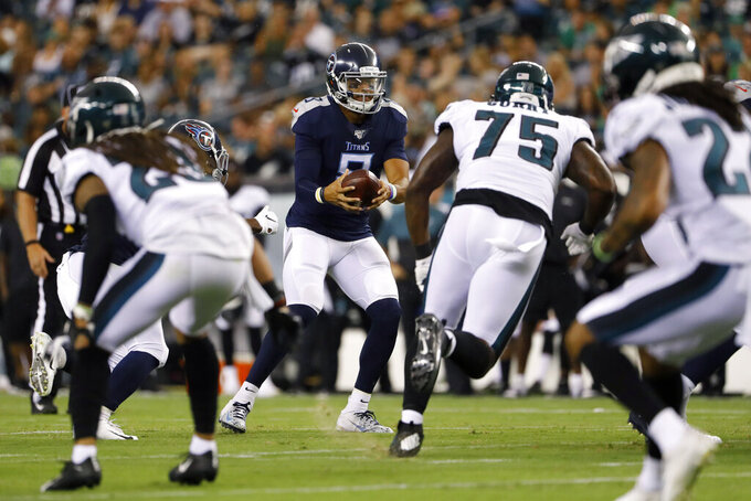 Tennessee Titans' Marcus Mariota takes a snap during the first half of the team's preseason NFL football game against the Philadelphia Eagles, Thursday, Aug. 8, 2019, in Philadelphia. (AP Photo/Matt Rourke)