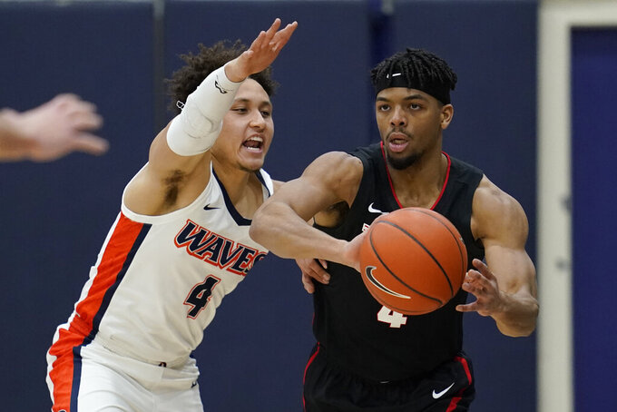 Gonzaga guard Aaron Cook (4) passes the ball away from Pepperdine guard Colbey Ross (4) during the first half of an NCAA college basketball game Saturday, Jan. 30, 2021, in Malibu, Calif. (AP Photo/Ashley Landis)