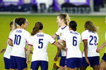 United States midfielder Samantha Mewis, center, celebrates after scoring a goal against Colombia on a penalty kick with teammates forward Carli Lloyd, defender Kelly O'Hara (5), forward Lynn Williams (6), and defender Catrina Macario (29) during the second half of an international friendly soccer match, Monday, Jan. 18, 2021, in Orlando, Fla. (AP Photo/John Raoux)