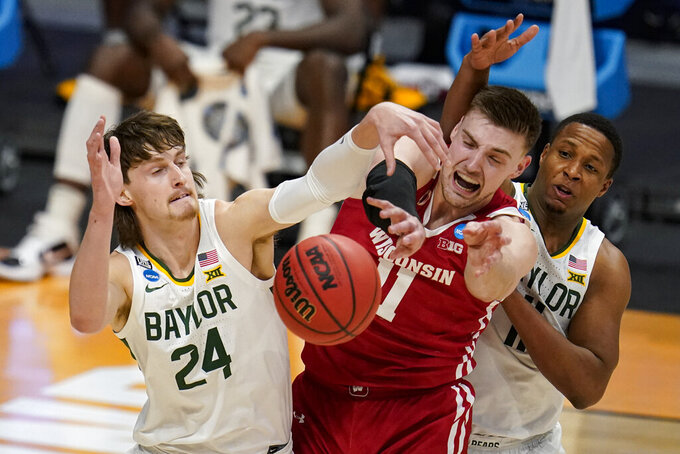 Baylor guard Matthew Mayer (24) blocks the shot of Wisconsin forward Micah Potter (11) in the first half of a second-round game in the NCAA men's college basketball tournament at Hinkle Fieldhouse in Indianapolis, Sunday, March 21, 2021. (AP Photo/Michael Conroy)