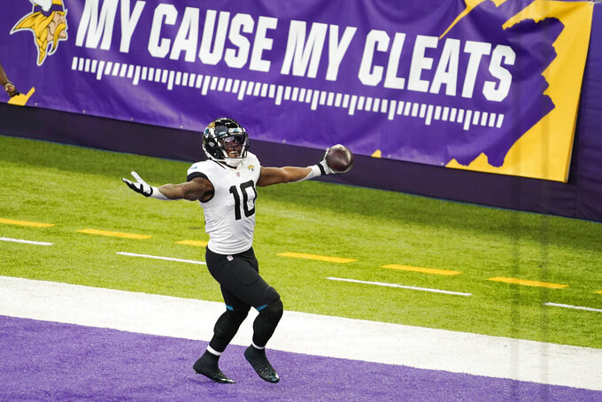 Jacksonville Jaguars wide receiver Laviska Shenault Jr. celebrates after catching a 28-yard touchdown pass during the first half of an NFL football game against the Minnesota Vikings, Sunday, Dec. 6, 2020, in Minneapolis. (AP Photo/Jim Mone)