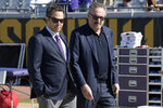 FILE - In this Dec. 11, 2016, file photo, Minnesota Vikings owners Mark Wilf, left, and Zygi Wilf watch warmups from the sideline before an NFL football game against the Jacksonville Jaguars in Jacksonville, Fla. The owners of the Minnesota Vikings have finalized the acquisition of Orlando City, giving the Wilf family control of the MLS franchise.  (AP Photo/Phelan M. Ebenhack, File)
