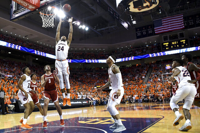 Auburn forward Anfernee McLemore (24) grabs a rebound over Alabama during the first half of an NCAA college basketball game, Wednesday, Feb. 12, 2020, in Auburn, Ala. (AP Photo/Julie Bennett)