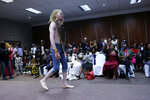 A contestant walks on stage, during the Mr and Miss Zimbabwe Albinism pageant held in Harare, early Saturday, May 25, 2019. About 70,000 of Zimbabwe's estimated 16 million people are born with albinism, according to government figures. They often stand out, making them a subject at times of discrimination, ridicule and dangerously misguided beliefs. The Mr. and Miss Albinism Zimbabwe competition, now in its second year, is a chance to push back. (AP Photo/Tsvangirayi Mukwazhi)