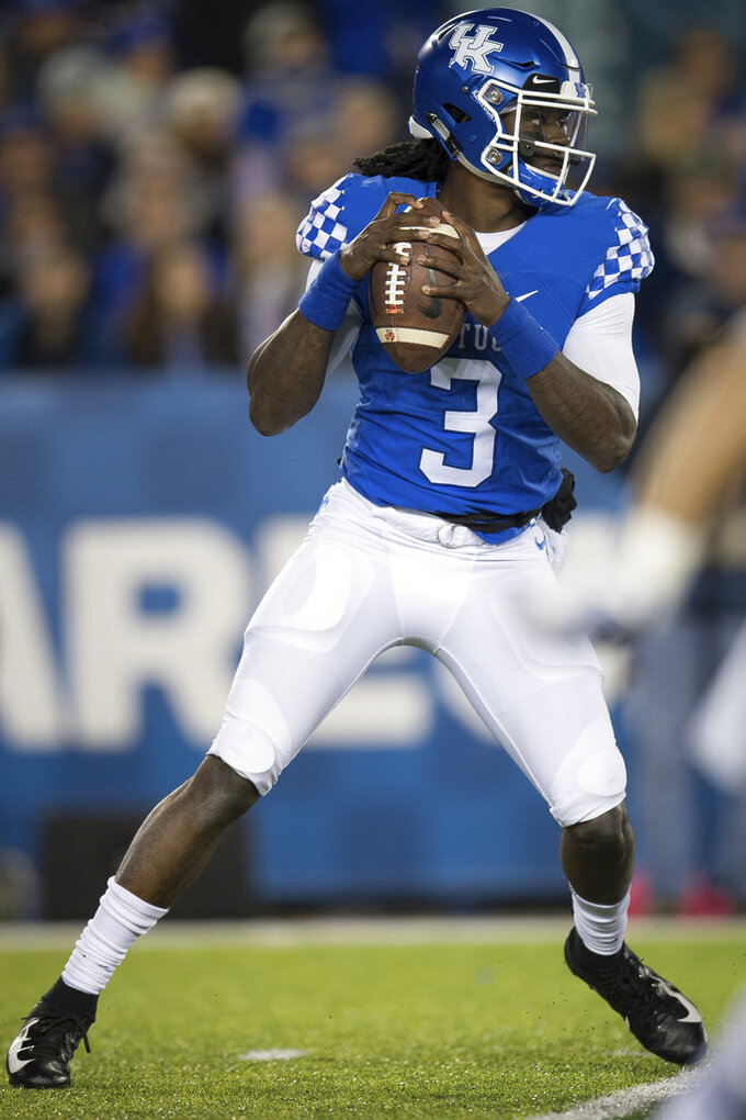 Kentucky quarterback Terry Wilson (3) prepares to pass the ball during the first half of an NCAA college football game against Vanderbilt in Lexington, Ky., Saturday, Oct. 20, 2018. (AP Photo/Bryan Woolston)