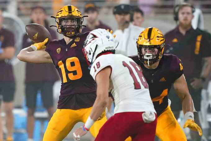 Arizona State wide receiver Ricky Pearsall (19) throws for a completion against Southern Utah during the first half of an NCAA college football game, Thursday, Sept. 2, 2021, in Tempe, Ariz. (AP Photo/Matt York)