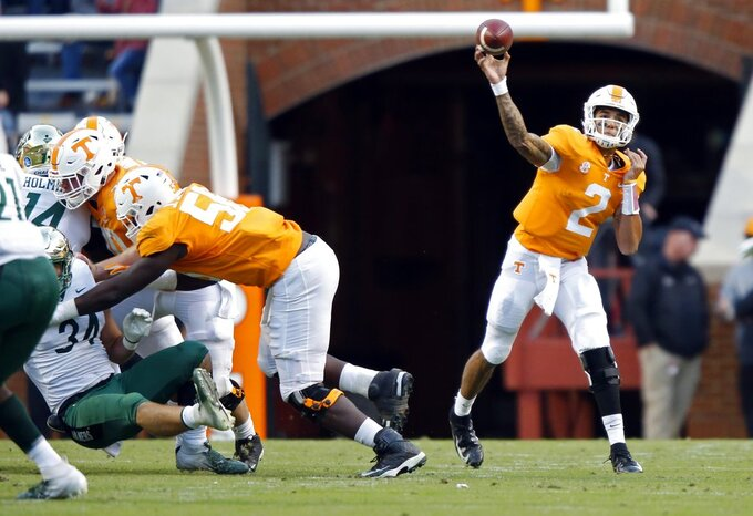 Tennessee quarterback Jarrett Guarantano (2) throws to a receiver in the second half of an NCAA college football game against Charlotte Saturday, Nov. 3, 2018, in Knoxville, Tenn. Tennessee won 14-3. (AP Photo/Wade Payne)