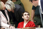 Florida school shooting defendant Nikolas Cruz is surrounded by his defense attorneys Melisa McNeill, left, Diane Cuddihy and Gabe Ermine, right, after entering the courtroom for a hearing at the Broward County Courthouse in Fort Lauderdale, Fla., on Wednesday, Jan. 22, 2020. (Amy Beth Bennett/South Florida Sun-Sentinel via AP, Pool)