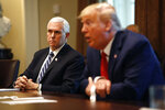 President Donald Trump speaks as Vice President Mike Pence listens during a meeting with supply chain distributors in the Cabinet Room of the White House, Sunday, March 29, 2020, in Washington. (AP Photo/Patrick Semansky)