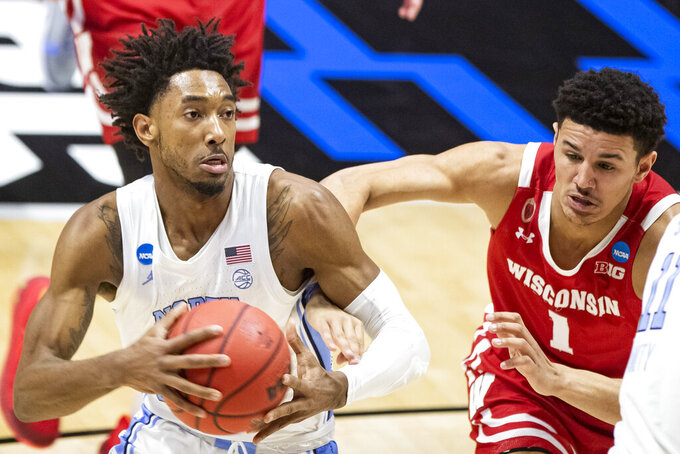 North Carolina's Leaky Black, left, drives in against Wisconsin's Jonathan Davis (1) during the first half of a first-round game in the NCAA men's college basketball tournament, Friday, March 19, 2021, at Mackey Arena in West Lafayette, Ind. (AP Photo/Robert Franklin)