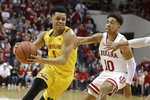 Maryland's Anthony Cowan Jr. (1) goes to the basket against Indiana's Rob Phinisee (10) during the second half of an NCAA college basketball game, Sunday, Jan. 26, 2020, in Bloomington, Ind. (AP Photo/Darron Cummings)