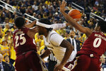 Elon guard Hunter Woods (25) knocks the ball away from Michigan guard Zavier Simpson (3) during the second half of an NCAA college basketball game, Friday, Nov. 15, 2019, in Ann Arbor, Mich. (AP Photo/Carlos Osorio)
