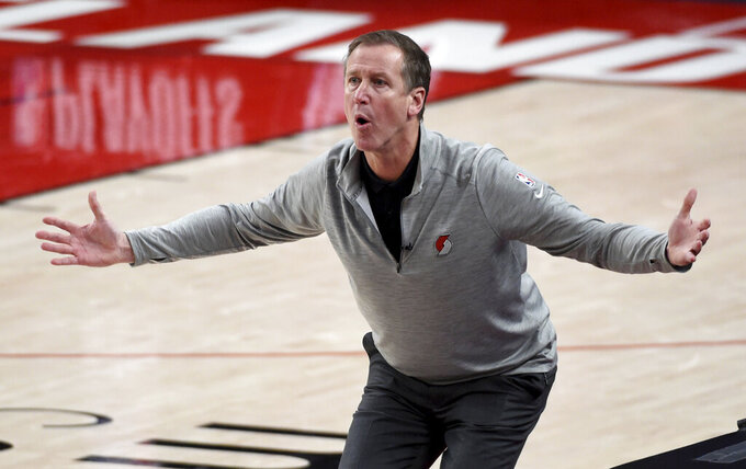 Portland Trail Blazers head coach Terry Stotts reacts to an official's call during the first half of Game 4 of an NBA basketball first-round playoff series against the Denver Nuggets in Portland, Ore., Saturday, May 29, 2021. (AP Photo/Steve Dykes)