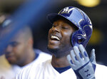 Milwaukee Brewers' Lorenzo Cain celebrates in the dugout after hitting a solo home run in the third inning of a baseball game against the Chicago Cubs, Wednesday, June 13, 2018, in Milwaukee. (AP Photo/Aaron Gash)