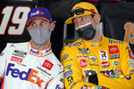 Denny Hamlin, left, and Kyle Busch joke around in the garages during a NASCAR Daytona 500 auto race practice session at Daytona International Speedway, Wednesday, Feb. 10, 2021, in Daytona Beach, Fla. (AP Photo/John Raoux)