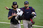 Atlanta Braves starting pitcher Ian Anderson and catcher Travis d'Arnaud walk to the dugout before Game 2 of a baseball National League Championship Series against the Los Angeles Dodgers Tuesday, Oct. 13, 2020, in Arlington, Texas. (AP Photo/Tony Gutierrez)