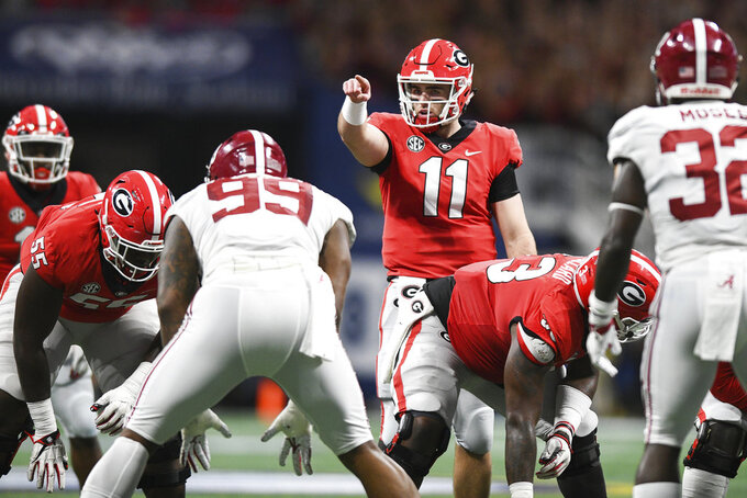 Georgia quarterback Jake Fromm (11) points during an NCAA college football game against Alabama for the Southeastern Conference championship Saturday, Dec. 1, 2018, in Atlanta. (AJ Reynolds/Athens Banner-Herald via AP)