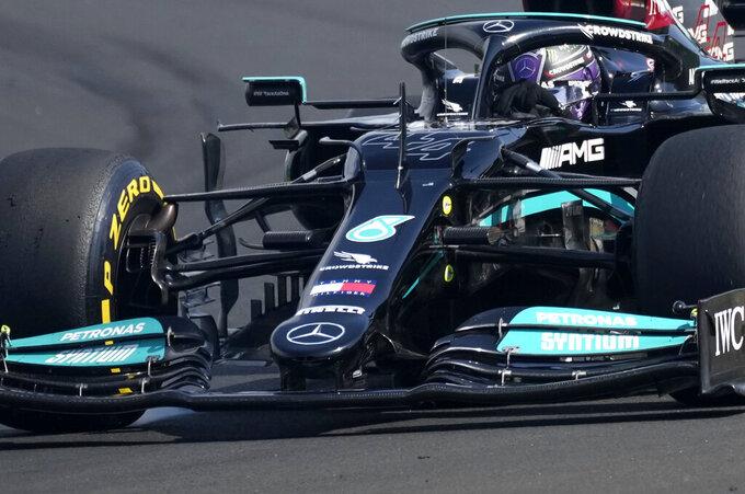 Mercedes driver Lewis Hamilton of Britain steers his car during the Hungarian Formula One Grand Prix at the Hungaroring racetrack in Mogyorod, Hungary, Sunday, Aug. 1, 2021. (AP Photo/Darko Bandic)