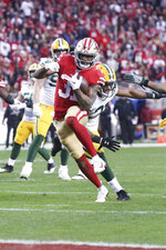 San Francisco 49ers running back Raheem Mostert (31) carries the ball for a touchdown in the NFL NFC Championship football game against the Green Bay Packers, Sunday, Jan. 19, 2020 in Santa Clara, Calif. The 49ers defeated the Packers 37-20. (Margaret Bowles via AP)