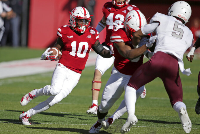 Nebraska wide receiver JD Spielman (10) runs with the ball as Bethune-Cookman safety Kennedy Ndukwe (5) is blocked by wide receiver Stanley Morgan Jr. (8) during the first half of an NCAA college football game in Lincoln, Neb., Saturday, Oct. 27, 2018. (AP Photo/Nati Harnik)