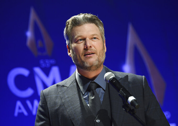 """FILE - In this Nov. 13, 2019, file photo, singer Blake Shelton speaks in the press room after winning single of the year award for """"God's Country"""" at the 53rd annual CMA Awards at Bridgestone Arena in Nashville, Tenn. The CMA will provide 4 million meals in cities with large populations of musicians and music industry professionals in partnership with Feeding America, and will also launch a donation challenge to fund  additional meals through its MICS Covid-19 initiative Monday, May 10, 2021. Shelton said he is proud to be part of the initiative and drumming up more support to raise funds for the food banks. (Photo by Evan Agostini/Invision/AP, File)"""