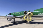 This image from CBS Denver shows a Key Lime Air Metroliner that landed safely at Centennial Airport after a mid-air collision near Denver on Wednesday, May 12, 2021. Federal officials say two airplanes collided but that there are no injuries. The collision between a twin-engine Fairchild Metroliner and a single-engine Cirrus SR22 happened as both planes were landing, according to the National Transportation Safety Board. Key Lime Air, which owns the Metroliner, says its aircraft sustained substantial damage to the tail section but that the pilot was able to land safely. (CBS Denver via AP)