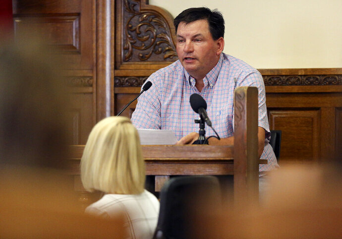 Jerry Frasher testifies in Todd Mullis' murder trial Wednesday, Sept. 18, 2019, at the Dubuque County Courthouse in Dubuque, Iowa. Authorities say Mullis fatally attacked his wife, 39-year-old Amy Mullis, in November at her farm northwest of Earlville, Iowa. (Dave Kettering/Telegraph Herald via AP)