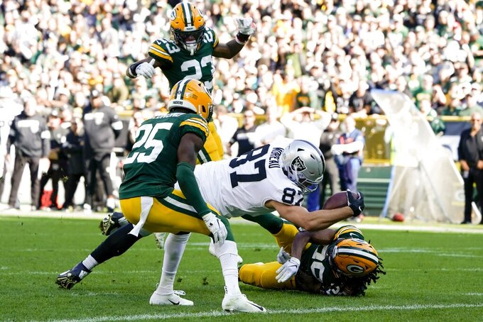 Oakland Raiders' Foster Moreau dives into the end zone for a touchdown catch during the first half of an NFL football game against the Green Bay Packers Sunday, Oct. 20, 2019, in Green Bay, Wis. (AP Photo/Morry Gash)