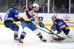 Colorado Avalanche's Brandon Saad (20) is unable to score past St. Louis Blues goaltender Jordan Binnington (50) and Jake Walman (46) during the third period of an NHL hockey game Thursday, April 22, 2021, in St. Louis. (AP Photo/Jeff Roberson)
