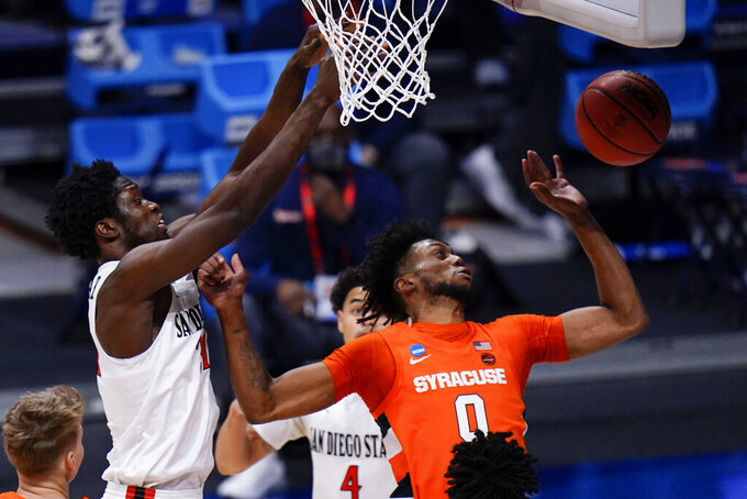 Syracuse forward Alan Griffin (0) tries to save a rebound in front of San Diego State forward Nathan Mensah (31) during the first half of a college basketball game in the first round of the NCAA tournament at Hinkle Fieldhouse in Indianapolis, Friday, March 19, 2021. (AP Photo/AJ Mast)