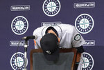 Seattle Mariners right fielder Ichiro Suzuki bows at the end of a press conference to announce his retirement after Game 2 of the Major League baseball opening series between the Mariners and the Oakland Athletics in Tokyo Friday, March 22, 2019. (AP Photo/Eugene Hoshiko)