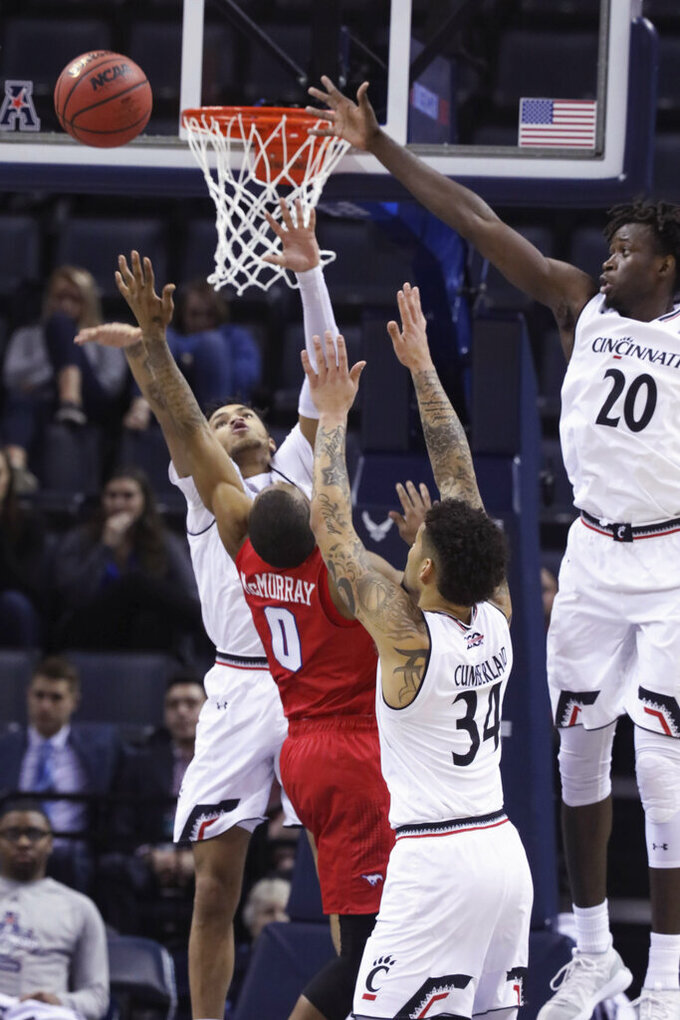 SMU's Jahmal McMurray attempts a shot while defended by Cincinnati's Cane Broome, Jarron Cumberland, and Mamoudou Diarra, from left, during the second half of an NCAA college basketball game at the American Athletic Conference men's tournament Friday, March 15, 2019, in Memphis, Tenn. (AP Photo/Troy Glasgow)