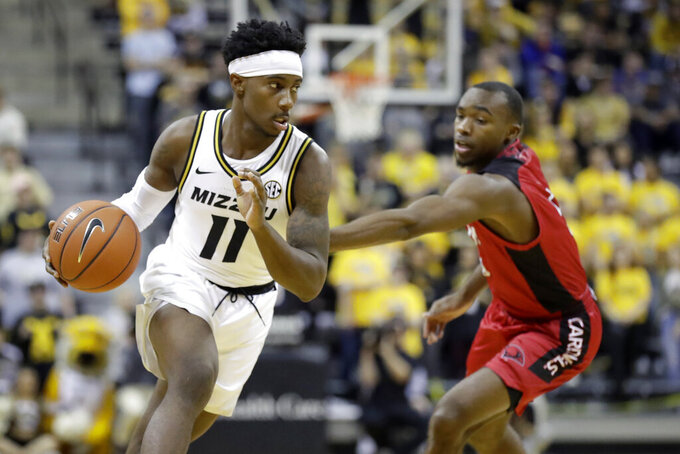 Missouri's Mario McKinney Jr. (11) dribbles around Incarnate Word's Dwight Murray Jr. during the second half of an NCAA college basketball game Wednesday, Nov. 6, 2019, in Columbia, Mo. (AP Photo/Jeff Roberson)