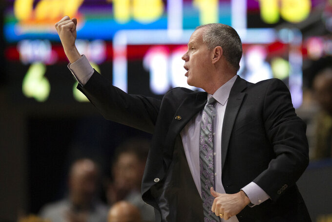 Colorado coach Tad Boyle calls in a play to his team during the first half of an NCAA college basketball game against California, Thursday, Feb. 27, 2020, in Berkeley, Calif. (AP Photo/D. Ross Cameron)