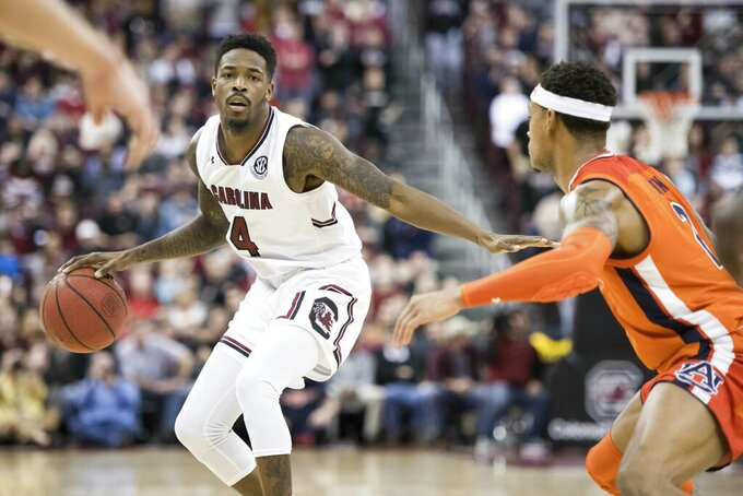 South Carolina guard Tre Campbell (4) dribbles the ball against Auburn guard Bryce Brown (2) during the second half of an NCAA college basketball game Tuesday, Jan. 22, 2019, in Columbia, S.C. South Carolina defeated Auburn 80-77. (AP Photo/Sean Rayford)
