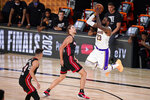 Los Angeles Lakers' LeBron James (23) takes a shot over Miami Heat's Kelly Olynyk (9) during the second half in Game 6 of basketball's NBA Finals Sunday, Oct. 11, 2020, in Lake Buena Vista, Fla. (AP Photo/Mark J. Terrill)