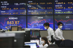Currency traders work at the foreign exchange dealing room of the KEB Hana Bank headquarters in Seoul, South Korea, Tuesday, Sept. 29, 2020. Asian stocks were mixed Tuesday after Wall Street recovered some of this month's losses as investors looked ahead to a debate between President Donald Trump and his challenger in the November election, former Vice President Joe Biden. (AP Photo/Ahn Young-joon)