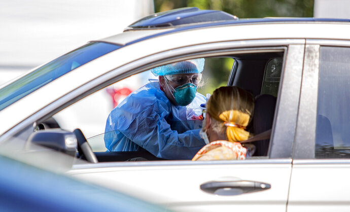 Tidelands Health medical professionals conduct a drive-through COVID-19 testing site Friday July 17, 2020 at Myrtle Beach Pelicans Ballpark in Myrtle Beach, S.C. (Josh Bell/The Sun News via AP)