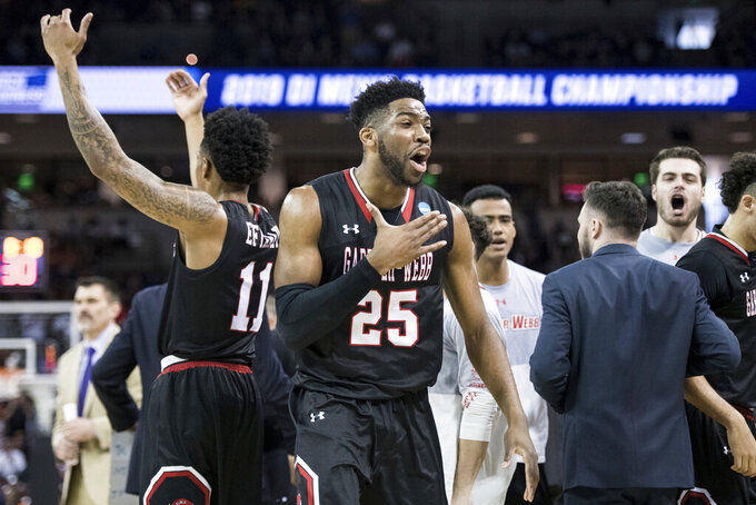 Gardner Webb forward DJ Laster (25) celebrates after a play against Virginia during a first-round game in the NCAA men's college basketball tournament Friday, March 22, 2019, in Columbia, S.C. (AP Photo/Sean Rayford)