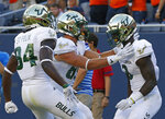 South Florida's Darnell Salomon, right, celebrates his touchdown against Illinois with teammates Randall St. Felix, left, and Mitchell Wilcox during the second half of an NCAA college football game Saturday, Sept. 15, 2018, in Chicago. (AP Photo/Jim Young)