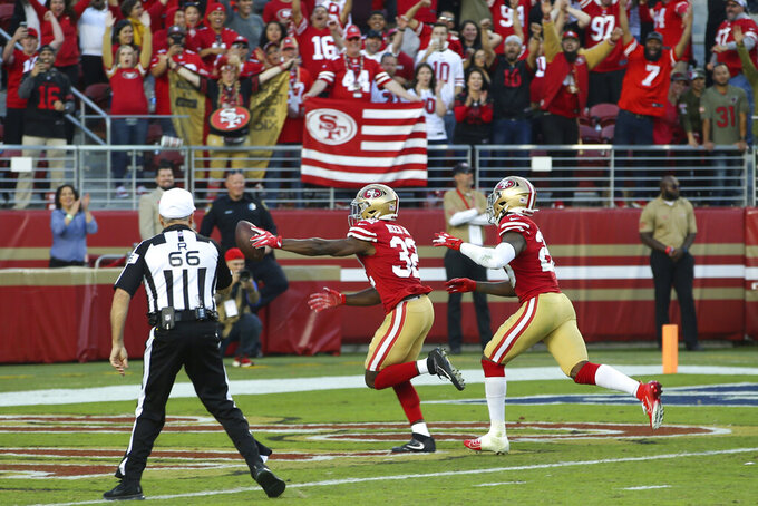 San Francisco 49ers free safety D.J. Reed Jr. (32) returns a fumble to score against the Arizona Cardinals during the second half of an NFL football game in Santa Clara, Calif., Sunday, Nov. 17, 2019. (AP Photo/John Hefti)
