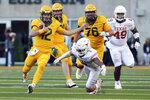 Baylor quarterback Charlie Brewer (12) runs the ball against Texas in the third quarter in an NCAA college football game Saturday, Nov. 23, 2019, in Waco, Texas. (AP Photo/Richard W. Rodriguez)