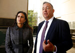Attorney's Harmeet Dhillon, left , and Justin Clark, right, who represented the state and national Republican parties, discuss the tentative ruling by a federal judge to halt a California law that's aimed at forcing the president to release his tax returns, in Sacramento, Calif., Thursday, Sept. 19, 2019. U.S.District Judge Morrison England Jr., said the will issue a formal ruling by Oct. 1. (AP Photo/Rich Pedroncelli)